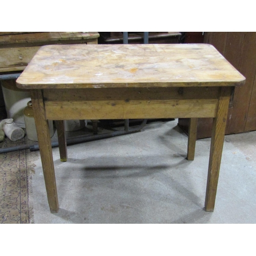 A small vintage pine kitchen table of rectangular form with rounded corners and single end frieze drawer raised on square cut and slightly tapered supports, 97 cm long x 63 cm wide x 73 cm high (AF)