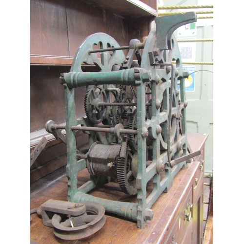 2541 - A Victorian turret clock mechanism, the two train movement within a cast iron frame with original pa...