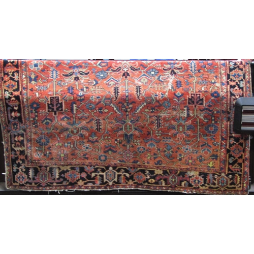 2518 - A coarse Persian style wool carpet, with red ground, multi geometric detail and set within running b...