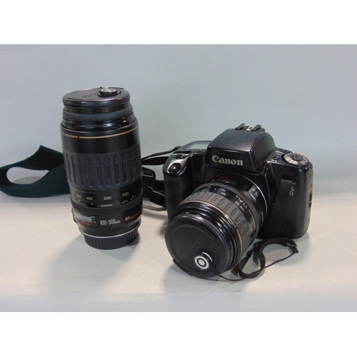 Canon EOX 100 camera with 28-80mm lens and further 100-300 lens within a Leman camera bag