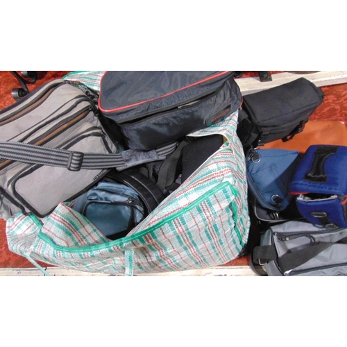 592 - A large collection of camera bags and related items...