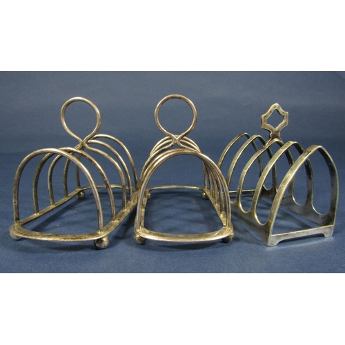 65 - Three silver four divisional toast racks, 6oz approx...