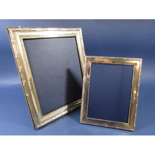 50 - A large silver applied easel picture frame, 31 x 21cm together with a further smaller example (2)...