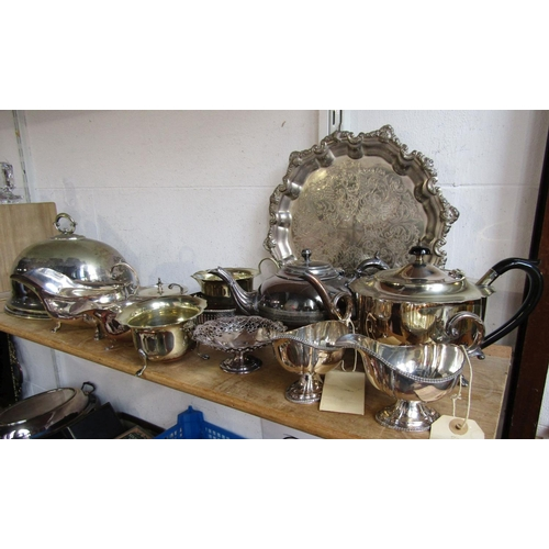 10 - A mixed collection of silver plated items comprising a three piece bachelor tea service, a cloche, a...