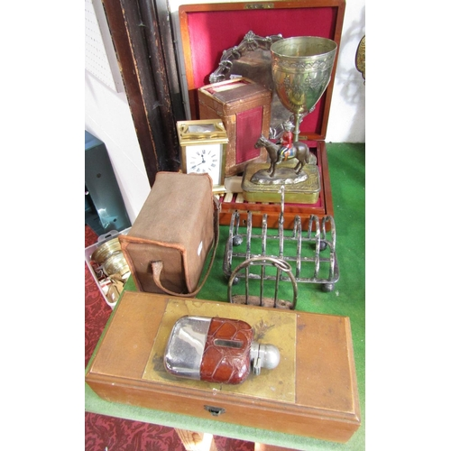 11 - A mixed lot comprising a canteen of silver plated fish cutlery, a chalice, a toast rack, together wi...