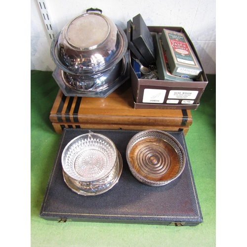14 - A mixed silver plated lot comprising an art deco canteen of cutlery, two lidded entrée dishes, wine ...