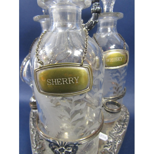 2 - Three good quality cut glass decanters, each etched with fern leaves and with faceted shoulders, wit...