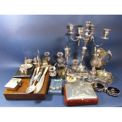 25 - A good collection of silver plated items comprising two four branch candelabra (one af) part canteen...