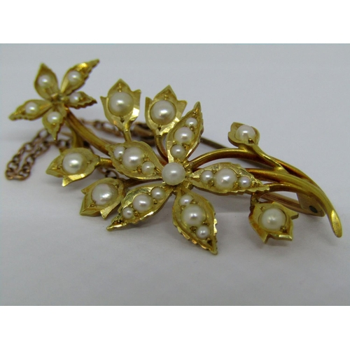 Edwardian 15ct floral spray brooch set with seed pearls, 4.3cm approx, 4.7g (one pearl vacant)