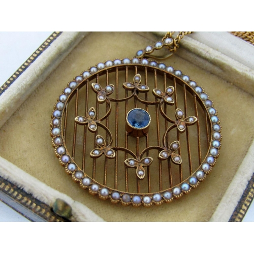 278 - Good quality circular Art Deco pendant set with a sapphire and seed pearls, in unmarked yellow metal...
