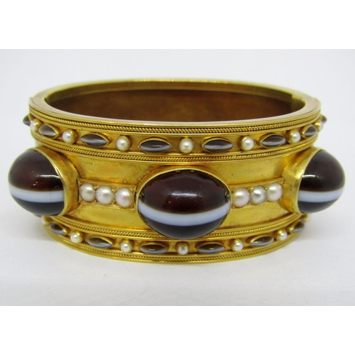 279 - Fine antique hinged bangle ornately set with Scottish banded agate cabochons and split pearls, in un...
