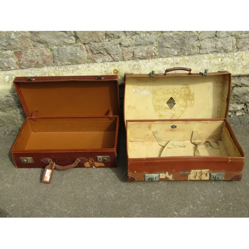 2010 - A vintage Revelation tan coloured vulcanized fibre suitcase with stitched leather handle and metal f...