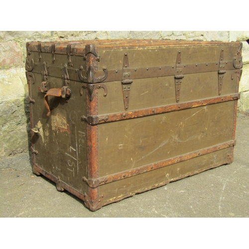 2018 - A 19th century fibre and timber lathe bound cabin trunk, with studded leather reinforced corners and...