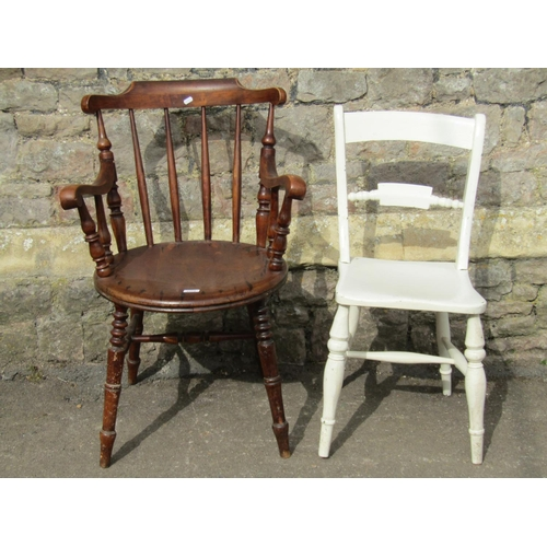 2019 - A Swedish stained beechwood stick back elbow chair with circular seat, raised on turned supports (af...