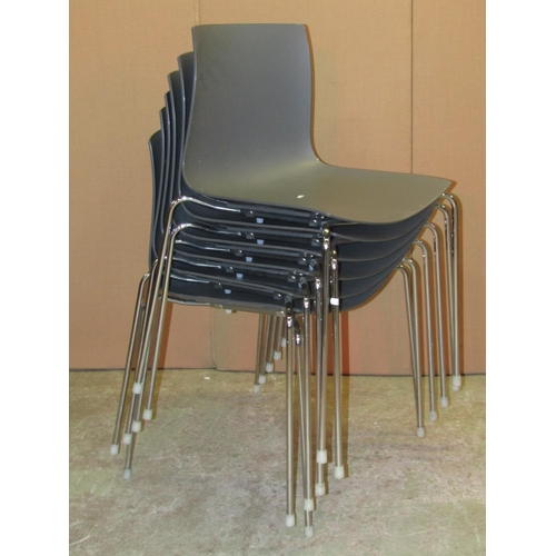 2020 - A set of six contemporary stacking dining chairs with moulded seats and polished chrome supports, st...