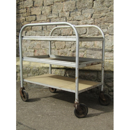 2021 - An industrial tubular steel framed three tier trolley, with removeable rectangular trays (one missin...