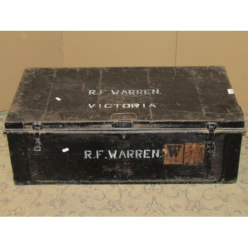 2036 - A vintage japanned tin trunk, possibly military related, with painted lettering RF Warren Victoria, ...