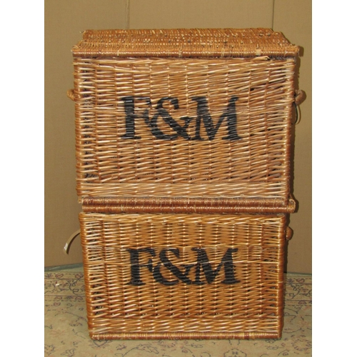 2044 - Two wicker hampers with fixed side carrying handles and painted lettering F & M for Fortnum and Maso...