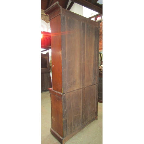 2051 - 19th century mahogany chiffonier bookcase in two sections the lower enclosed by a pair of arched mou...