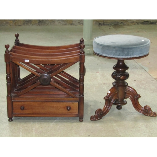 2055 - A good quality Victorian rosewood piano or music stool, with circular revolving upholstered seat, ra...