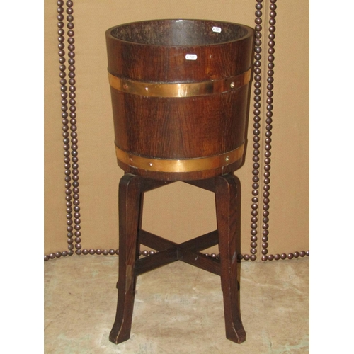 2057 - R A Lister & Co Ltd coopered oak and brass banded jardinière and stand, 36cm diameter x 76cm high (f...