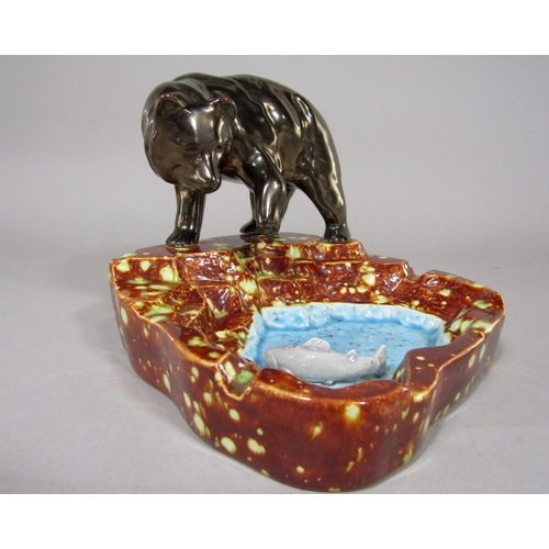 An unusual ash tray modelled as a bear hunting a salmon with incised mark to base Paul and dated 85, 12 cm tall approximately