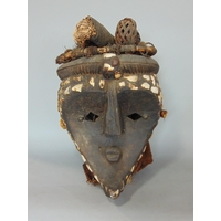 Tribal interest - vintage African full tribal Cameroon  head dress, inlaid with shells and mounted with worked timber and twine, upon a modern wooden stand, 40 inches high