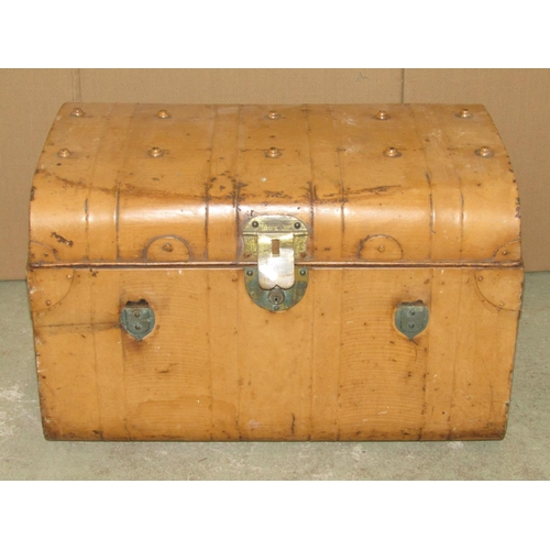 2016 - A vintage fibre and wooden lathe bound domed top travelling trunk, together with two further tin tru...