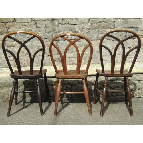 2594 - A well matched harlequin collection of six antique Windsor lattice back kitchen chairs all with elm ...