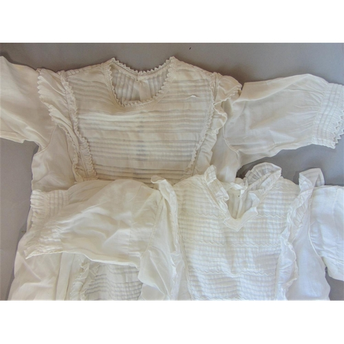 2 early 20th century baby gowns with long pleated front panels and hand embroidery, both approx 105 long, with note indicating Royal connection to Princess Mary (2)