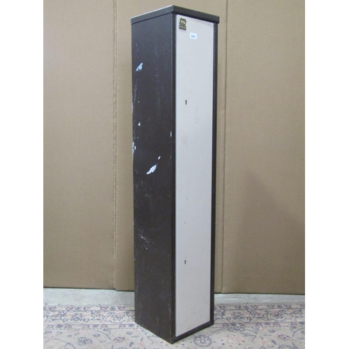 2005 - A steel gun cabinet enclosed by a single full length door with two locks and keys (brown and cream c...