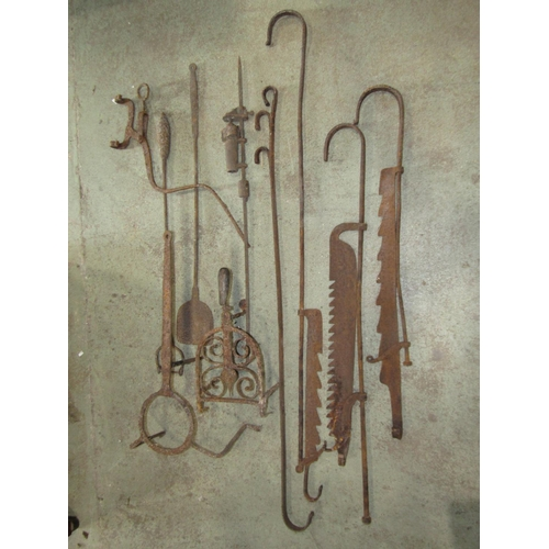 2037 - A small collection of antique metalware to include two 19th century iron trivets chimney cranes etc...