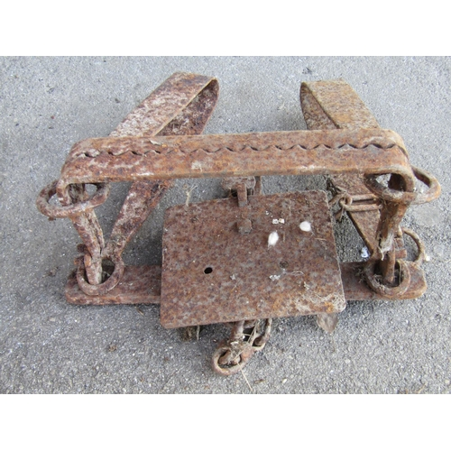 2038 - A collection of antique agricultural related ironwork etc to include a trap, branding iron, spiked l...