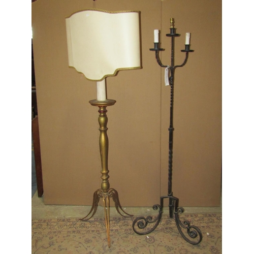 2058A - A ironwork three branch standard lamp with scrolled tripod supports together with a giltwood standar...