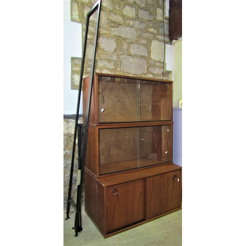 2048 - An Avalon modular teak wall unit comprising three cabinets, two metal uprights and six brackets...