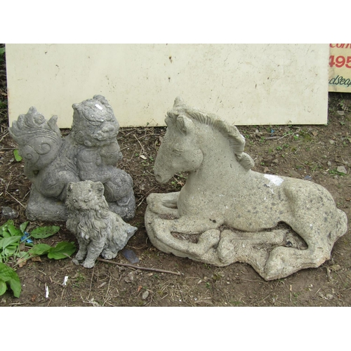 11 - Reclaimed figure of a recumbent foal, a kitten and a Chinese temple lion 60 cm and smaller...