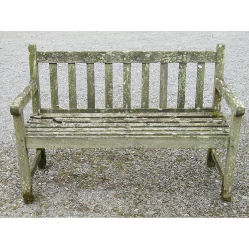 13 - A teakwood garden bench 122 cm long...