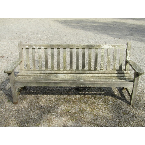 15 - A teakwood garden bench 192 cm wide...