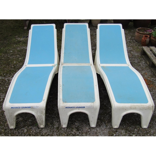 16 - Three glass fibre poolside loungers for Monaco lounger in a white and blue colourway...