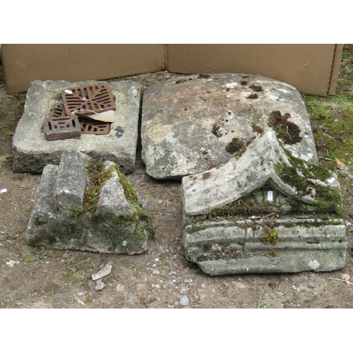 24 - A limestone drain cover of rectangular form, a further limestone domed cap and two further carved li...