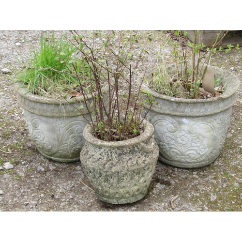 30 - Three reclaimed garden pots with individual moulded detail, 40 cm diameter and smaller...