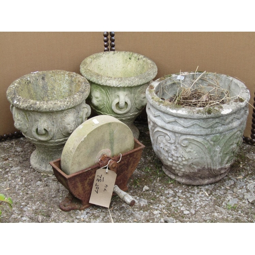 32 - Four reclaimed garden pots together with a small sharpening wheel in an iron work frame...