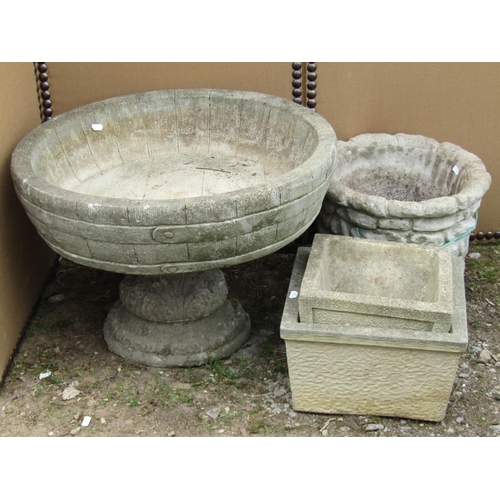 33 - Four reclaimed garden pots, one of open shallow form raised on a fluted column 60 cm diameter and sm...