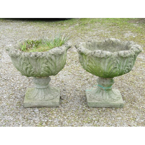 42 - A pair of reclaimed fluted garden pots with acanthus detail on square cut bases, 45 cm in height...