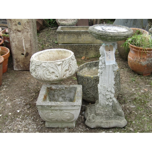 43 - Three reclaimed pots of various shapes and sizes together with a bird bath with butterfly and ivy le...