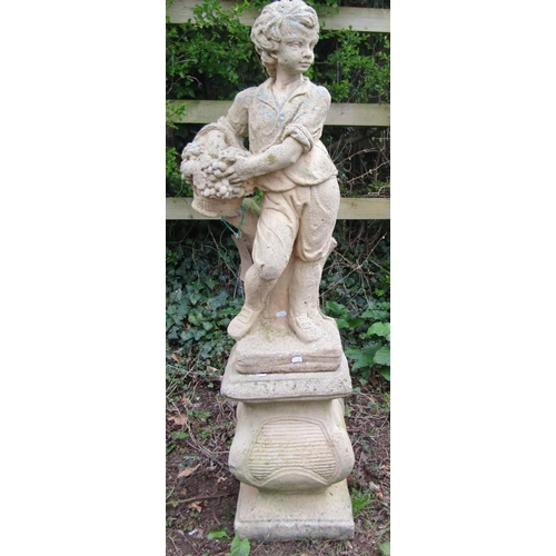 5 - Reclaimed figure of a boy holding fruit standing upon a plinth 120 cm approx...