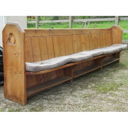 50 - A Victorian pine pew with panelled framework, the shaped ends with simple gothic tracery detail, 315...