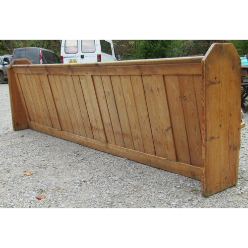 51 - A Victorian pine pew with panelled framework, the shaped ends with simple gothic tracery detail, 315...