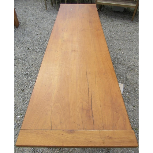 52 - A traditional oak refectory table, the heavy plank top with cleated ends raised on a stretcher base ...