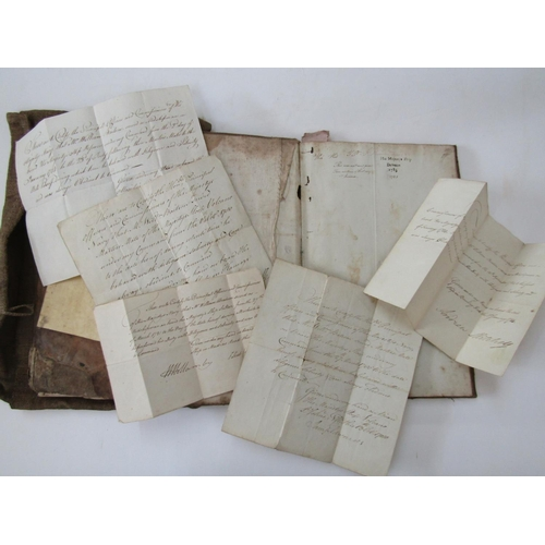 333 - A hand stitched coarse linen sailors pouch containing two 18th century ship's journals hand written ...